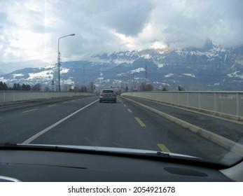 Buchs, Switzerland February 22, 2019 Passing the rhine bridge from Liechtenstein on a cloudy winter day
