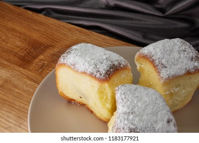 Buchty - Czech traditional sweet dessert sprinkled with powder sugar usually filled with poppy seeds, special jam (called povidla) or quark.