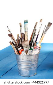 bucket of brushes