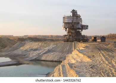 Bucket chain excavator in a sand quarry. Giant stacker. Bulk material handling