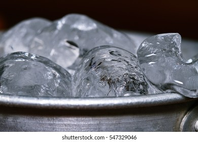 Bucket with cold ice cubes.