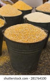 a bucket of corn animal feed