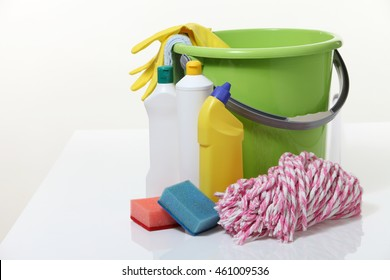 bucket and detergents with mop on the white background