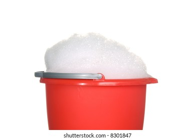 Bucket of foamy cleaning detergent waiting to be used