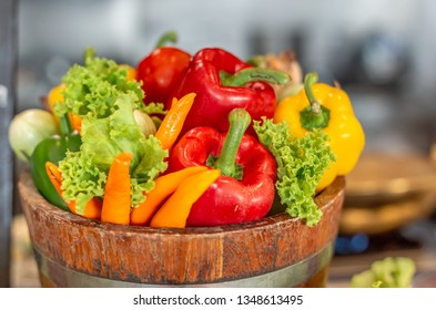 Bucket of fresh vegetable include chilis paprika and lettuce