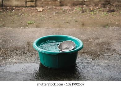 Bucket harvesting of rainy season