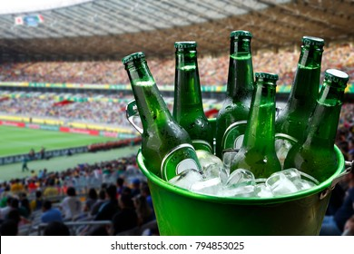 Bucket with ice and bottles of beer at football stadium