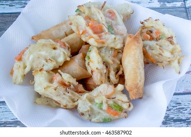 Bucket of Indonesian Snack ,bakwan / vegetables fritter and deep fried spring rolls