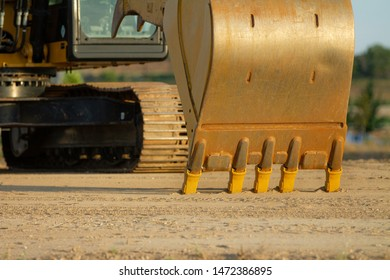 bucket for a piece of heavy equipment getting ready to dig into the earth