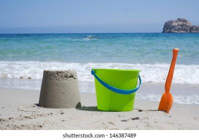 Bucket and shovel on a sandy beach