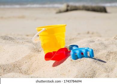 bucket, shovel, rake on the beach sand