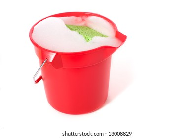 A bucket of soapy water on a white background with copy space