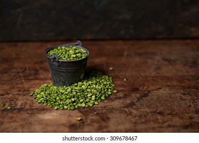 Bucket of Split Peas on Rustic Wood