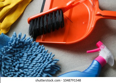 Bucket with sponges, chemicals bottles, brushes, towel and rubber gloves. Household equipment, spring-cleaning, tidying up, cleaning service concept, copy space