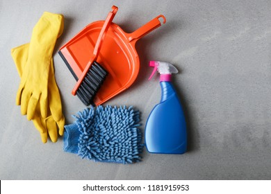 Bucket with sponges, chemicals bottles, brushes, towel and rubber gloves. Household equipment, spring-cleaning, tidying up, cleaning service concept, copy space.Cleaning products. Home cleaning concep