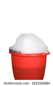 A bucket of suds is ready for use to clean something.