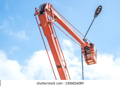 Bucket truck high up of a crane working for electricity.