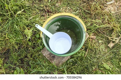 a bucket of water with a bucket
