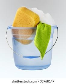 Bucket of water, soap suds, sponge and towel