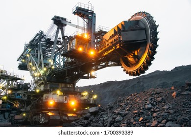 Bucket wheel excavator in a coal mine. Extraction of minerals.