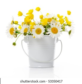 bucket with wildflowers on white