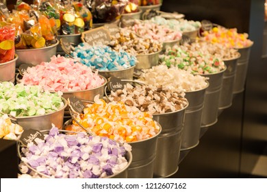 Buckets filled with taffy candy at a candy shop.