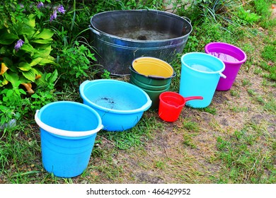 Buckets filled with water after heavy rain
