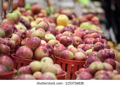 Buckets of Honeycrisp Apples for sale on a Canadian market in Montreal. It is a popular autumn fruit, a species developped specifically in America, as Canada and Quebec are big Apple producers