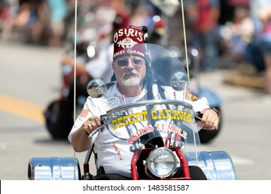 Buckhannon, West Virginia, USA - May 18, 2019: Strawberry Festival, Member of the Osiris Temple, riding a tricycle during the parade