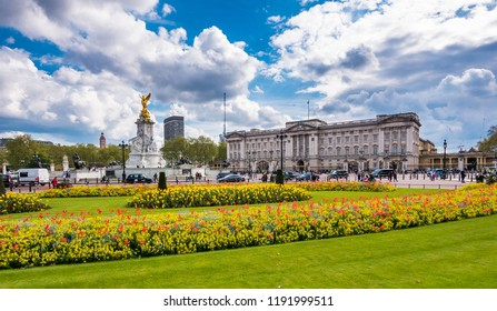 Buckingham palace square with flowers and sunny warm weather