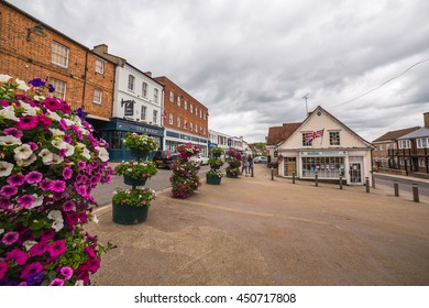 BUCKINGHAM, UK - 4TH JULY 2016: A view of Buckingham Town center during the day. People can be seen.