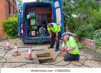 BUCKINGHAM, UK - August 07, 2015. Drain cleaning company unblocking sewage drain by jetting, UK