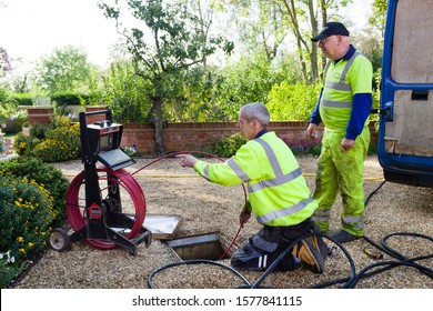 BUCKINGHAM, UK - October 16, 2019. A drain cleaning company checks a blocked drain with a camera prior to jetting