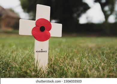 Buckingham, UK - September 02, 2019. Poppy remembrance day cross in a field, UK