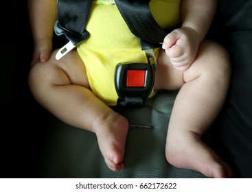 Buckle up! Baby save protection contest with unfasten seat belt in car seat.