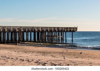 Buckroe Beach viewing pier with sandy beach in Hampton, Virginia.