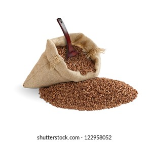 buckwheat in bag with spoon on white background