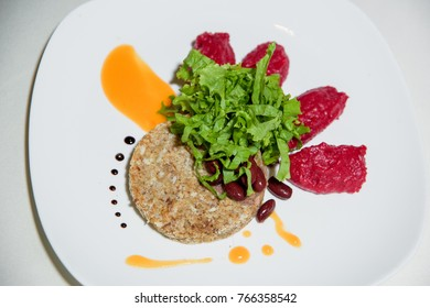 buckwheat cutlet with beet puree on white background