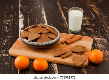 Buckwheat flour ginger breads on wooden background