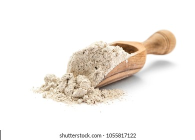 Buckwheat flour in scoop on white background