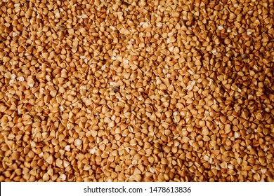 buckwheat grains background. fresh buckwheat. buckwheat texture. Textures from raw buckwheat grains. Healthy food. Top view. vintage photo processing