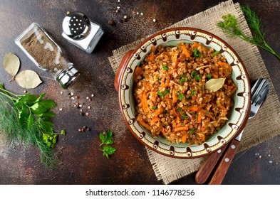Buckwheat in a merchant manner (stewed with minced meat and vegetables). Russian traditional cuisine