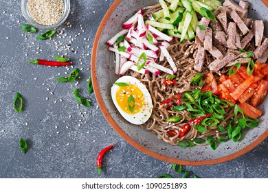 Buckwheat noodles  with beef, eggs and vegetables. Korean food.  Buckwheat pasta soup. Top view. Flat lay