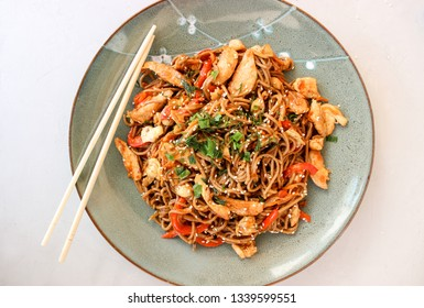 Buckwheat noodles with vegetables and chicken breast in the sauce teriyaki