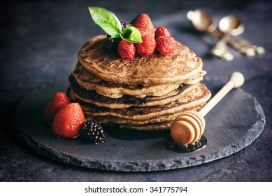 Buckwheat pancakes with berry fruit and honey.Selective focus