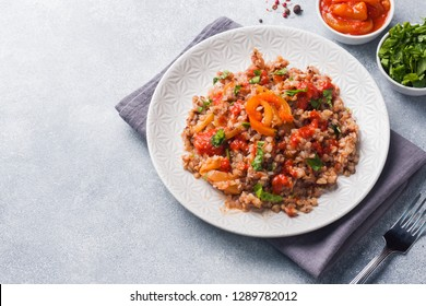 Buckwheat porridge with canned tomato and pepper Copy space
