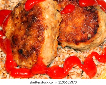 buckwheat porridge with ketchup and meat cutlet