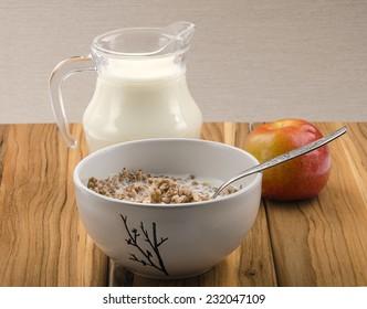 buckwheat porridge with milk in a ceramic bowl