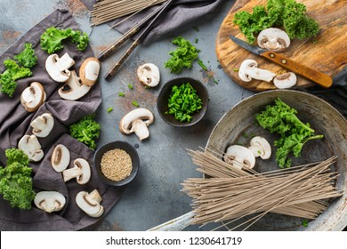 Buckwheat soba noodles soup ingredients for asian chinese japanese korean vietnamese food. Top view flat lay kitchen cooking background
