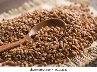 Buckwheat with a spoon on a wooden table
